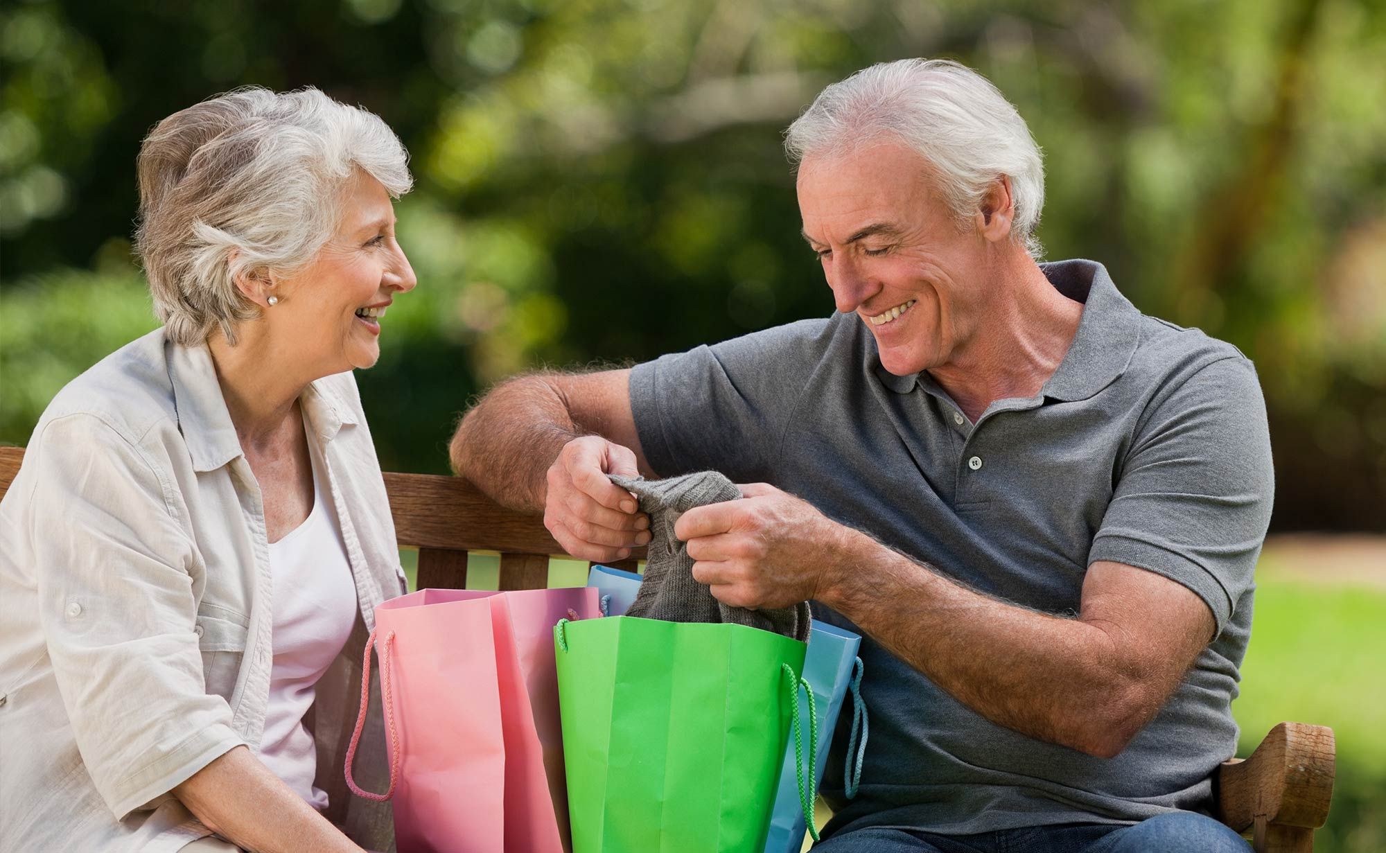 Active Aging Couple Looking at a Present